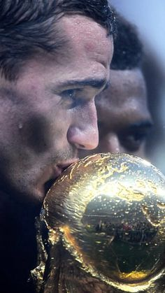 Antoine Griezmann of France kisses the World Cup trophy during the victory celebrations after the 2018 FIFA World Cup Russia Final between France and Croatia at Luzhniki Stadium on July 2018 in. Get premium, high resolution news photos at Getty Images World Cup Russia 2018, World Cup 2018, Fifa World Cup, Antoine Griezmann, Soccer Guys, Football Players, World Cup Trophy, France Team, France Football