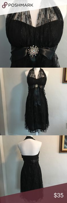 Betsy & Adam Formal dress Gorgeous dress. Perfect condition. Zipper up the side. Very well lined inside. Lined with thin padding in bust area. Measures 39 1/2 inches from top of shoulder to end of dress lining. Lace falls over End 1 inch. Arm pit to armpit across back of dress measures l3 inches. Cup size would be approx 34b. Dresses