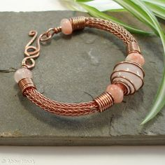 I make Viking Knit jewelry and other items, I just have to figure out how to post pictures for others to see. Torcesque - Rose Quartz and Copper bracelet Rose Quartz Bracelet, Copper Bracelet, Copper Jewelry, Wire Jewelry, Beaded Jewelry, Handmade Jewelry, Copper Wire, Men's Jewellery, Wire Bracelets