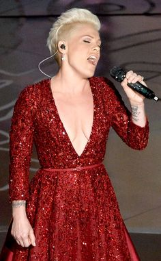 """Pink went Ruby Red at the 2014 Oscars Show while she performed """"Over the Rainbow"""". It was part of the 75-year anniversary tribute to The Wizard of Oz."""
