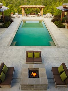 imposing pavers or stamped concrete around pool with new england