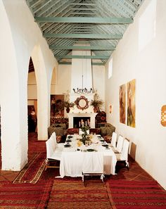 The main dining room in the former old chapel at Trasierra, a small hotel in Andalusia, Spain.