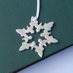 Mother of Pearl Porcelain Snowflake Hanging Decoration. £10.00, via Etsy.