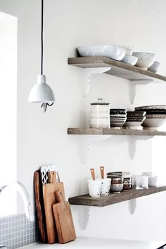 "Really love these ""disappearing"" natural wood shelves. Use same-colored brackets on walls."
