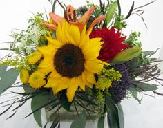 A cube arrangement featuring sunflowers and seasonal favorites by Concord Flower Shop