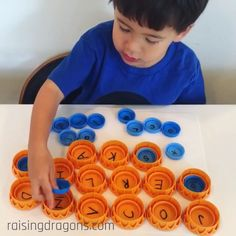 Alphabet Lids 💡 ages 3-6 💡 We love this idea of using beverage container lids to practice learning letters. We used orange juice lids and milk carton lids (which happen to fit perfectly inside the orange juice lids). Write uppercase letters on the large lids and lowercase letters on the small lids and ask them to find the matching letters. So simple and fun! Thank to Mrs. F. for this awesome idea! 👍🏻 #prek #kindergarten #preschool #diy #homeschool #homeschooling