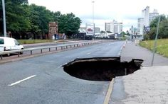 This giant 40ft deep hole opened up on the Mancunian Way in August 2015 - with fears the road could be shut for weeks. Traffic was halted in both directions after the crater - measuring at least 15 feet - appeared at the Ancoats end of the busy Manchester commuter route