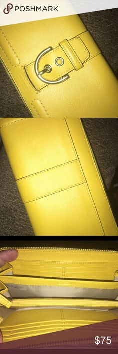 Coach Wallet EUC Coach Wallet in Bright Lemon color and Silver Hardware! It has 12 slots for cards, 2 full size slip pickets and middle divider! The exterior has s full size slip pocket in back Closure by snap with the buckle accent measures approx 8 x 4 x 1 🚫no trades price firm🚫 Coach Bags Wallets