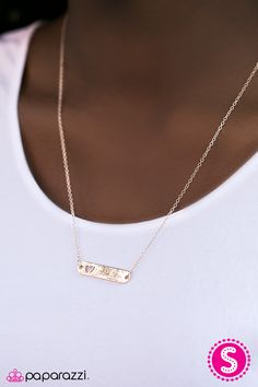 """A rose gold bar is suspended horizontally between two rose gold chains, creating a stationary pendant below the collar. Brushed in a shiny finish, a dainty heart cutout embellishes one side of the frame for a charming finish. Features an adjustable clasp closure.    Sold as one individual necklace. Includes one pair of matching earrings.   Get The Complete Look!  Bracelet: """"You Make My Heart Smile - Rose Gold"""" (Sold Separately)"""