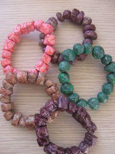 Papier mache bead bracelets.....glittered with nail varnish....