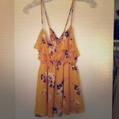 Yellow floral tank Flowy chiffon fabric tank with spaghetti straps that cross in the back. Empire waist. Very figure flattering. Nwot. Never worn. Forever 21 Tops Tank Tops