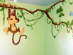 Muurschildering aapje aan tak