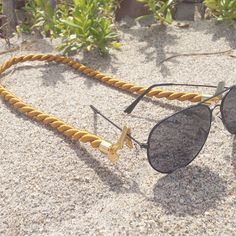 at the beach with Veronica DeOre statement eyewear jewerly // croakies // sunglasses straps // gold // rope // twisted cord // glasses // leash