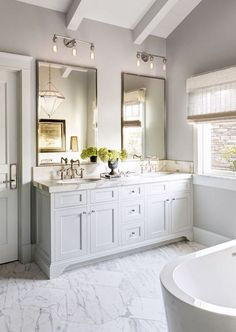 Marble floors, love the mirrors and vanity lights