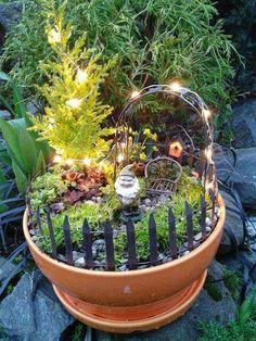 Magical fairy garden pot lights gnome chair trellace