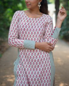Shop online Block print high slit top Floral block print top, with high slit giving a touch of contemporary to an otherwise indian look Neck Designs For Suits, Sleeves Designs For Dresses, Dress Neck Designs, Sleeve Designs, Blouse Designs, Printed Kurti Designs, Salwar Designs, Kurta Designs Women, Kurti Sleeves Design