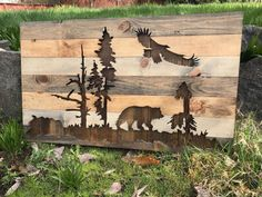 This is a completely one of a kind piece. There is no other like it out there. It features a silhouette cut out of a bear, eagle, trees and snags. It is very detailed down to every element of design. The bear and eagle silhouette in the nature gives it a very outdoorsy, rustic element. This piece is made out of pine uniquely stained to look like rustic reclaimed wood. It measures 36x21 and is preinstalled with a wire for hanging.  Custom orders for different sizes and cut outs are welcome…