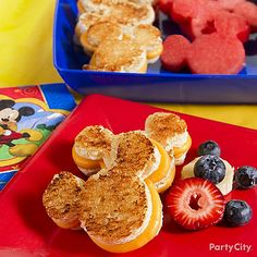 Mickey Mouse grilled cheese sandwiches and fruit - so easy with a cookie cutter. Such fun Mickey Mouse party food ideas! Click for recipes and how-to's!