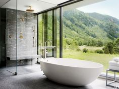 At an Aspen, Colorado, home created by architects Bohlin Cywinski Jackson and Shelton, Mindel & Assoc., the master bath's shower and Agape tub are equipped with Dornbracht fittings | archdigest.com