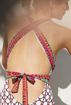 Love the mix of colors and prints...and the fact that it's a fashionable one piece!
