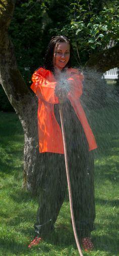 Having fun in rainwear Orange, Yellow, Rain Suit, Raincoat Jacket, Pictures Of People, Helly Hansen, Rain Wear, Women Wear, How To Wear