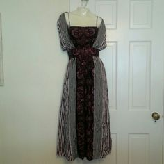 NWOT Free People Rare Stunning Long Dress This amazingly beautiful multi patterned dress is a rare find. Has a faux spaghetti strap with cold should sleeves. Has a sinched flattering high waisted and then is more flow at the bottom. Has a tie on the back so it doesn't fall off the shoulders and a cut out in the back. There is a hidden side zipper so it is easy to get on and take off Free People Dresses