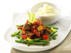 Beef stew with beans and mashed potatoes