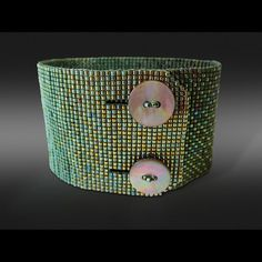 """92 Likes, 12 Comments - Leslie O'Neill (@seedbeadbliss) on Instagram: """"Signature double button wide ombré cuff in green, jury photo. ❤️ this one! #jewelrydesign…"""""""