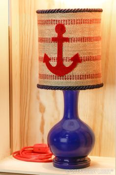 Need a ship-shape accent lamp for your favorite little sailor? Try jute webbing, twisted cord trim and a hand-cut felt anchor.