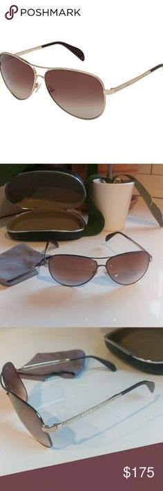 "Giorgio Armani Aviators Classics meet luxury in this high end pair of glossy gold aviators with chic brown lenses. Purchased several years ago at Sunglass Hut in Providence, RI. Authenticity guaranteed. Discontinued model. Right ""arm"" needs to be adjusted. Case has seen some wear, but glasses are in great condition. Includes GA cleaning cloth. Could be wrong, but I vaguely recall something about these being real gold, or maybe plated with real gold. Ask all questions before purchasing. (1st…"