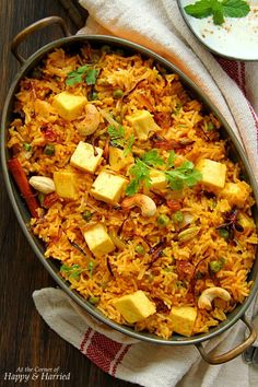 An aromatic and mildly spiced one-pot rice dish, this paneer dahi pulao (yogurt marinated paneer pilaf) is an easy option for both busy days and special nights. Paneer Recipes, Veg Recipes, Indian Food Recipes, Vegetarian Recipes, Cooking Recipes, Cooking Tips, Recipies, Paneer Dishes, Veg Dishes