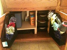 Bathroom Organization - Fun and useful ideas. Magazine holders on inside of door to keep curling irons and hair dryers in.
