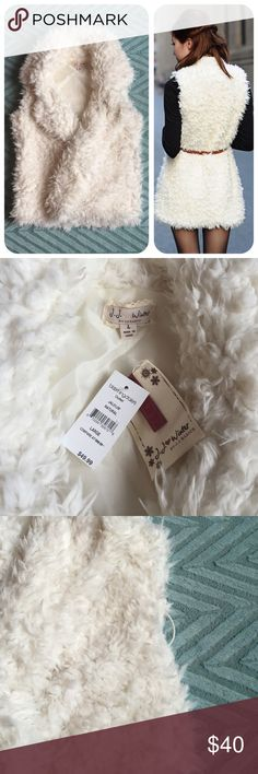 Super Chic Soft White Furry Vest So cute! NWT. Softest vest ever. 100% polyester. Tried to show in the 3rd photo that there are large sewn in belt loops, so you can easily rock this with a cute belt! Jackets & Coats Vests