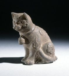 Side Seated cat wearing a collar with bell attached. The back of the cat's head is damaged and decorated with a flower. On its back is an auspicious character. Made of cast iron. © The Trustees of the British Museum Pretty Things, Sphinx, International Cat Day, Sculptures, Lion Sculpture, Maneki Neko, Vintage Cat, Ancient Artifacts, British Museum