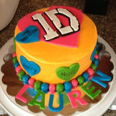 One direction 1D birthday cake. Buttercream icing with fondant accents.