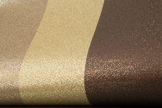Glitter Stripe (DL40791) - Albany Wallpapers - A stunning all over holographic style glitter wallcovering - in a wide stripe design - with a smooth touch finish. Shown in 3 shades of gold and chocolate brown. Please request sample for true colour and texture. Free pattern match. For best results we recommend you line your walls first to ensure a smooth surface.