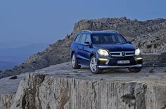 "The all-new Mercedes Banz GL 63 AMG, has a better specification than the GL 350 BlueTEC AMG Sport, with key exterior elements including flared wheel arches with 21"" AMG five-twin-spoke light-alloy wheels in Titanium Grey; AMG high-performance braking system; Active Curve System with AirMATIC, which compensates the roll angle of the vehicle body when driving round bends; and an AMG sports exhaust system with two chromed twin tailpipes."