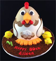 Birthday Cake Photos - A chicken cake! This is not my original design, that was done by Sam at Cakesaurus in Melbourne. The customer loved it so much she asked me to recreate the cake for her. I used white chocolate mud cake covered in white chocolate ganache for the chicken. Fondant was used to decorate her as well as make the chicks and the worm. The dirt is crushed up chocolate ripple biscuits. This is one of my favourite cakes!