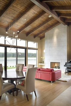 Smooth Stone Fireplace Rises to Vaulted Ceiling - The Aurea - 2453