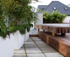 Designed for a young professional this roof garden had to be simple and sophisticated and easy to look after. There were many restrictions regarding weight and heights of existing parapet...