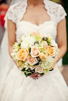 Peach and Apricot toned David Austins and standard roses, singapore clusters, hydrangea, brunei berry, freesias and dahlias