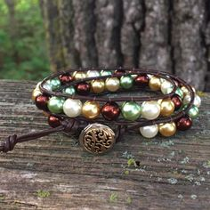 This bracelet has been one of my most popular. It's made of brown, white, gold and green pearled glass beads between smooth brown leather cording. The closure is an ornate gold and silver fin… Metal Buttons, Earth Tones, Glass Beads, Brown Leather, White Gold, Smooth, Beaded Bracelets, Closure, Popular
