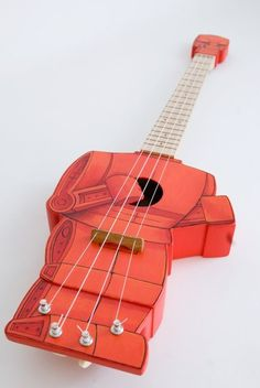 Coolest instrument EVER. Rock'em Sock'em robot ukulele (Robolele) $700  I love the detached head!