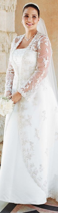 This is a strapless satin wedding dress with sleeves (bolero from David's) - read about plus size gowns for apple shapes -  http://www.boomerinas.com/2014/10/08/wedding-dresses-for-your-body-type-apple-shapes-plus-size-tummies/