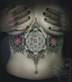 Under Boob tattoo. Geometric.