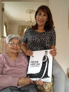 Freddie Mercury's mum, Jer Bulsara, and his sister, Kashmira Cooke, proudly holding the new illustrated Freddie biography