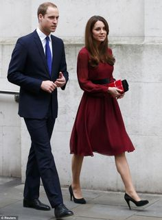 Picture perfect: Kate arrives at the National Portrait Gallery this morning for a viewing of her portrait with husband Prince William