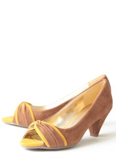 Mila Peep-toe Heels 38.99 at shopruche.com. Finished in soft faux suede, these chestnut-hued heels feature a twisted front with a touch of mustard yellow. Perfected with an open-toe design, these heels add unique sophistication to any look.Slightly padded footbed, Imported, 2