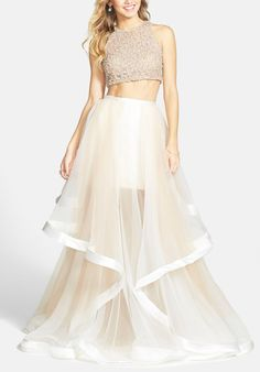 Dazzling beaded and organza two-piece ballgown in white/ nude.
