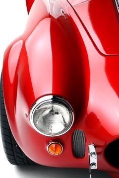 Red AC Cobra, unusual.